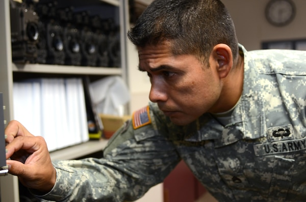 Army Staff Sgt. Esteban Sanchez, an instructor in the Basic Television Electronics Maintenance Course at the Defense Information School at Fort Meade, Md., powers up the vector scope on a test equipment rack Oct. 5, 2015. Originally from San Jose, Calif., Sanchez was chosen as the DINFOS Warrior of the Quarter in September. (U.S. Navy photo by Petty Officer 2nd Class John Suits)