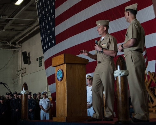 YOKOSUKA, Japan (Oct. 15, 2015) Master Chief Petty Officer of the Navy Mike Stevens, left, and Adm. John Richardson, chief of naval operations, address Sailors during an all-hands call in the hangar bay of the U.S. Navy™s only forward-deployed aircraft carrier USS Ronald Reagan (CVN 76). Ronald Reagan and its embarked air wing, Carrier Air Wing (CVW) 5, provide a combat-ready force that protects and defends the collective maritime interests of the U.S. and its allies and partners in the Indo-Asia-Pacific region.