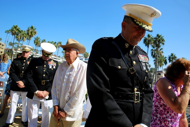 Major Gen. Daniel J. O'Donohue, commanding general, 1st Marine Division, bows his head during the invocation at Park Semper Fi's 10th anniversary ceremony in San Clemente, Calif., Oct. 11, 2015. Park Semper Fi was built to pay tribute to the Corps' honor, courage and commitment in service to the United States.