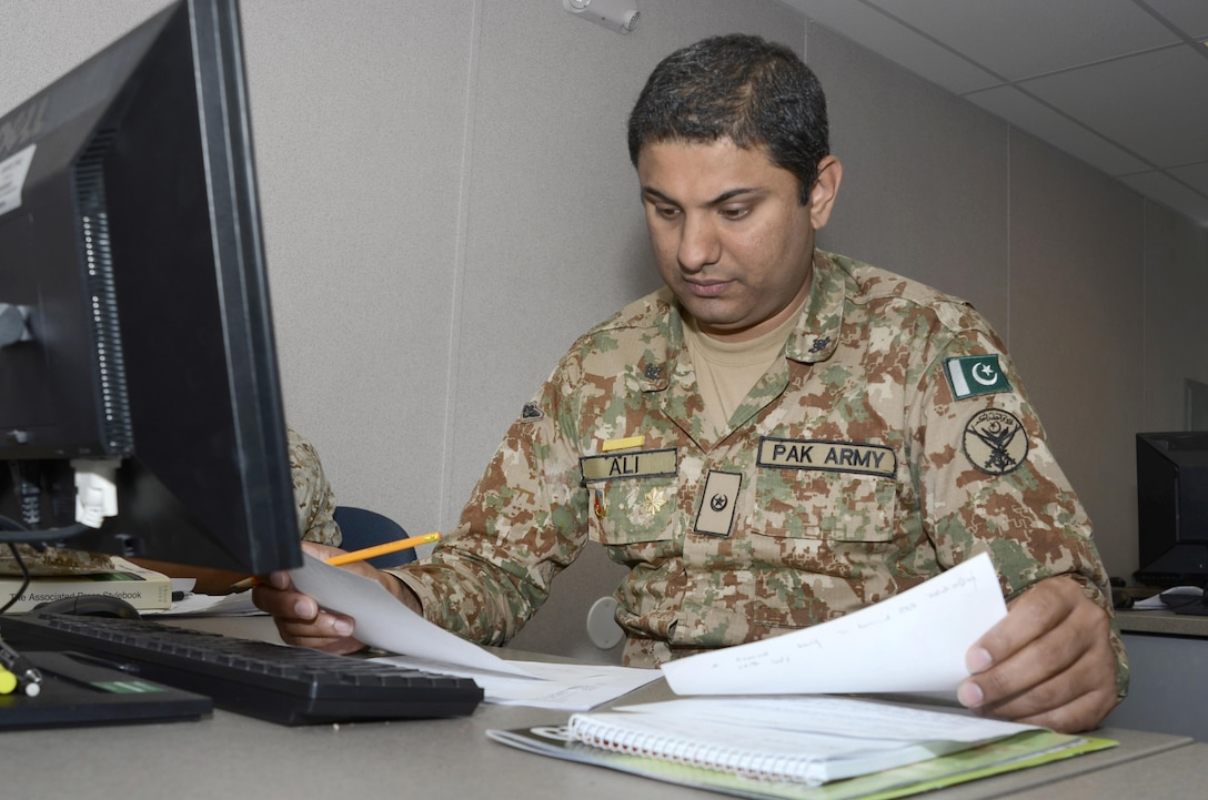 Pakistan Army Maj. Muhammad Ali, a student in the Basic Public Affairs Specialist Course at the Defense Information School on Fort Meade, Md., works on a feature story for the course on Oct. 5, 2015. Ali has been taking courses at DINFOS since March, and this trip is his first to the United States.