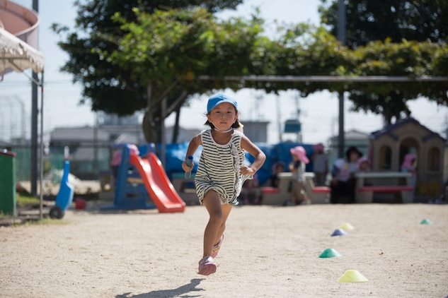 A preschooler from Kawashimo Preschool in Iwakuni, Yamaguchi Prefecture, Japan, scurries around the playground during a relay race at Kawashimo Preschool Sept. 29, 2015. Service members from Marine Corps Air Station Iwakuni visited the preschool to show their support and give back to the community.