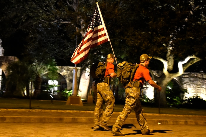 U.S. Air Force Airmen applaud Special Tactics Airmen as the ruck march on Joint Base San Antonio-Lackland, Oct. 4. The march covers more than 812 miles before ending at Hurlburt Field, Florida, in memory of fallen comrades since Sept. 11, 2001. Each Airman carries a 50-pound ruck to bring awareness to the service and sacrifice of Special Tactics members.