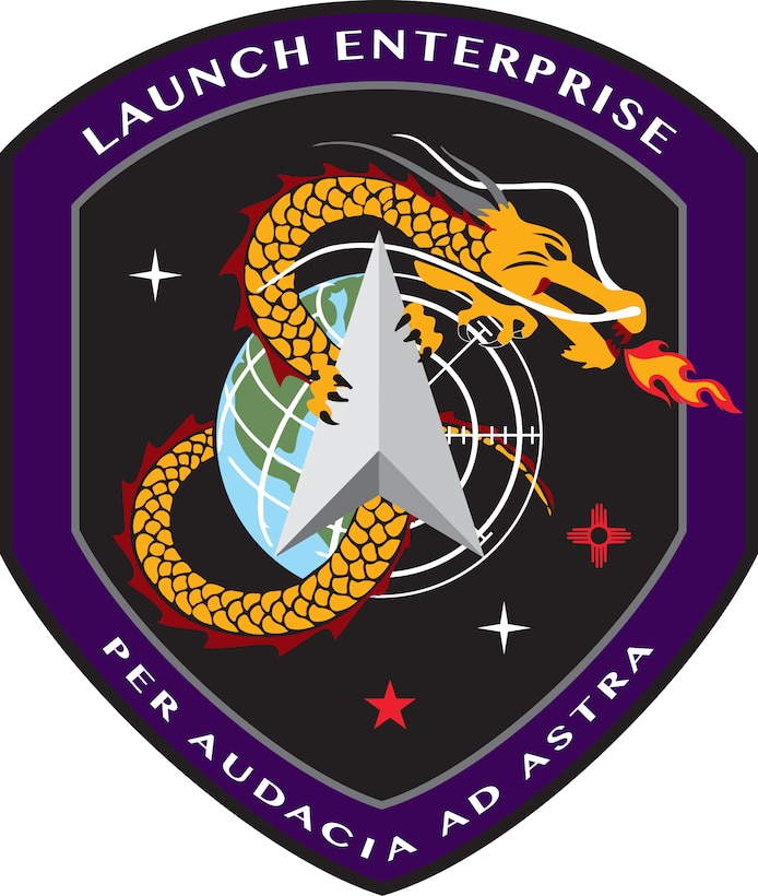 Space and Missile Systems Center's Launch Systems Enterprise (SMC/LE) shield. In accordance with AFI 84-105, chapter 3, commercial reproduction of this emblem is NOT permitted without the permission of the organization's commander.