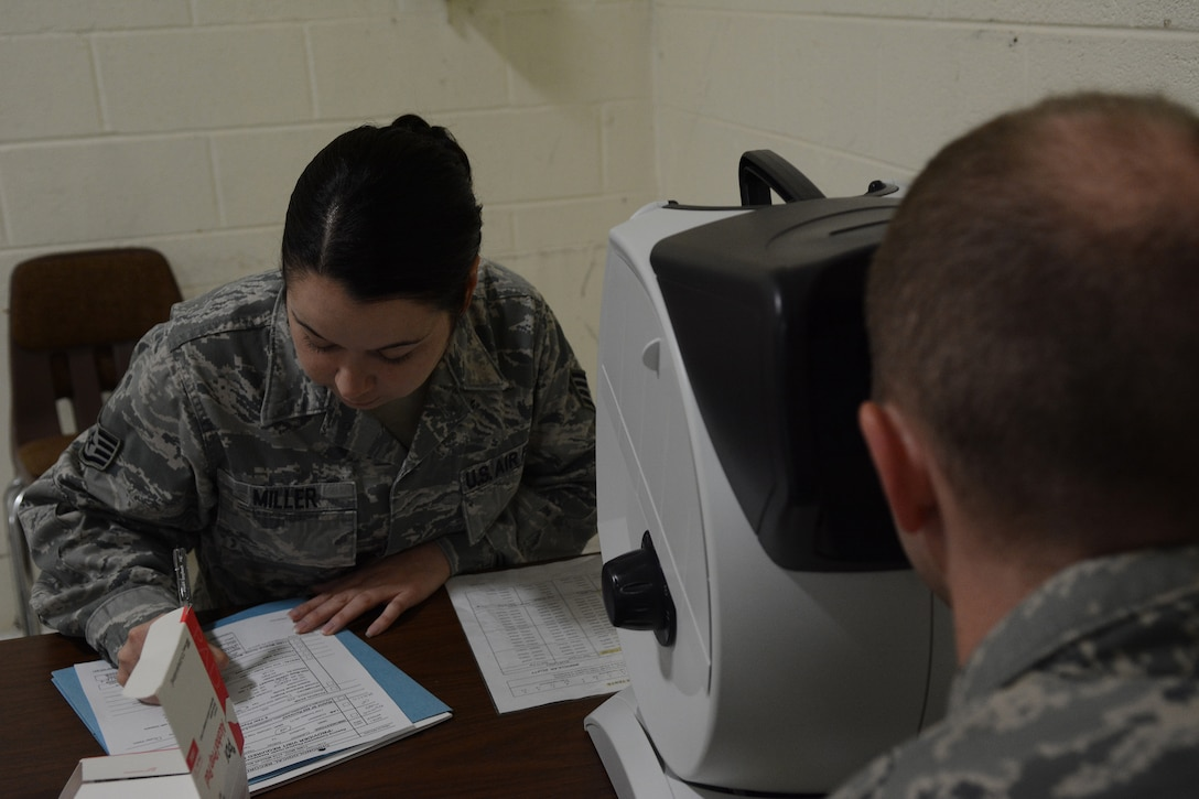 Staff Sgt. Spring Miller, 115th Medical Group, gives a vision test during the physical health assessments in building 510 at the 115th Fighter Wing, Madison, Wis., Oct. 3, 2015. More than 890 Airmen from the Wing were processed during the Quick PHA, designed to include less wait time, more time for members to spend in their respective squadrons throughout the year, and a more personalized one-on-one health care visit for each member. (U.S. Air National Guard photo by Senior Airman Andrea F. Rhode)