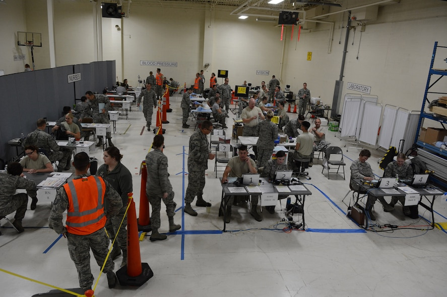 Airmen from the 115th Medical Group complete physical health assessments in building 510 at the 115th Fighter Wing, Madison, Wis., Oct. 3, 2015. More than 890 Airmen from the Wing were processed during the Quick PHA, designed to include less wait time, more time for members to spend in their respective squadrons throughout the year, and a more personalized one-on-one health care visit for each member. (U.S. Air National Guard photo by Senior Airman Andrea F. Rhode)