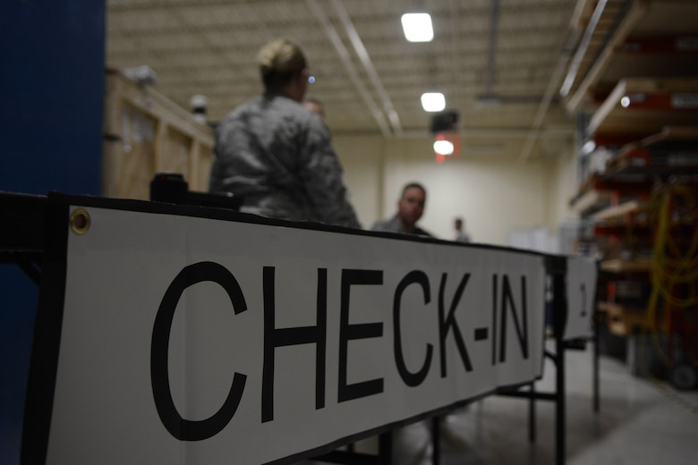 Airmen prepare for initial processing during the 115th Medical Group's Quick physical health assessments in building 510 at the 115th Fighter Wing, Madison, Wis., Oct. 3, 2015. More than 890 Airmen from the Wing were processed during the Quick PHA, designed to include less wait time, more time for members to spend in their respective squadrons throughout the year, and a more personalized one-on-one health care visit for each member. (U.S. Air National Guard photo by Senior Airman Andrea F. Rhode)