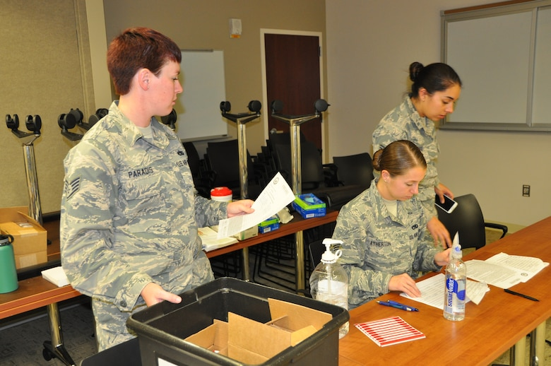 Staff Sgt. Jennifer Paradis of the 507th Medical Squadron's Drug Demand Reduction team ensures paperwork is in order during urinalysis testing Oct. 3, 2015, at Tinker Air Force Base, Okla. The DDR team is responsible for testing Tinker Airmen within the Reserve, which includes the 507th Air Refueling Wing, the 513th Air Control Group and the 35th Combat Communication Squadron. (U.S. Air Force photo/Tech. Sgt. Charles Taylor)