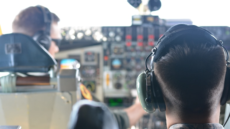 Senior Airman Donavan Furr, an aircraft hydraulics technician with the 507th Aircraft Maintenance Squadron, observes as the pilot and co-pilot complete the pre-landing checklist Oct. 3, 2015, at Tinker Air Force Base, Oklahoma. Furr was one of more than a dozen Airmen chosen to participate in an incentive flight for first-term airmen within the 507th Air Refueling Wing. (U.S. Air Force photo/Senior Airman Jeffery Dahlem)