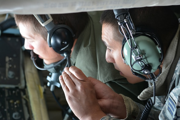Senior Airman Jon Becenti from the 507th Aircraft Maintenance Squadron observes as boom operator Staff Sgt. Dalton Williams with the 465th Air Refueling Squadron refuels a 513th Air Control Group E-3 Sentry Airborne Warning and Control System in mid-air Oct. 3, 2015, at Tinker Air Force Base, Oklahoma. Becenti and 13 other first-term Airmen from the 507th Air Refueling Wing were chosen to fly on an incentive flight to get a closer look at the 507th ARW's refueling mission. (U.S. Air Force photo/Senior Airman Jeffery Dahlem)