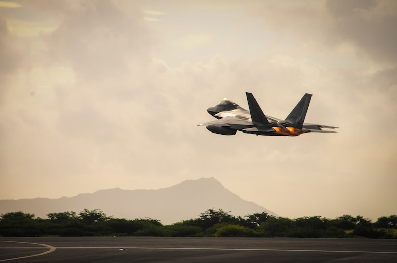 A Hawaii Air National Guard F-22 Raptor takes off from Joint Base Pearl Harbor-Hickam, Hawaii, Sept. 26, 2015. The Raptors deployed to the U.S. Central Command area of responsibility. It was the first combat deployment for the 199th Fighter Squadron since it deployed to Saudi Arabia in 2000 to patrol the southern no-fly zone of Iraq. (U.S. Air National Guard photo/Airman 1st Class Robert Cabuco)