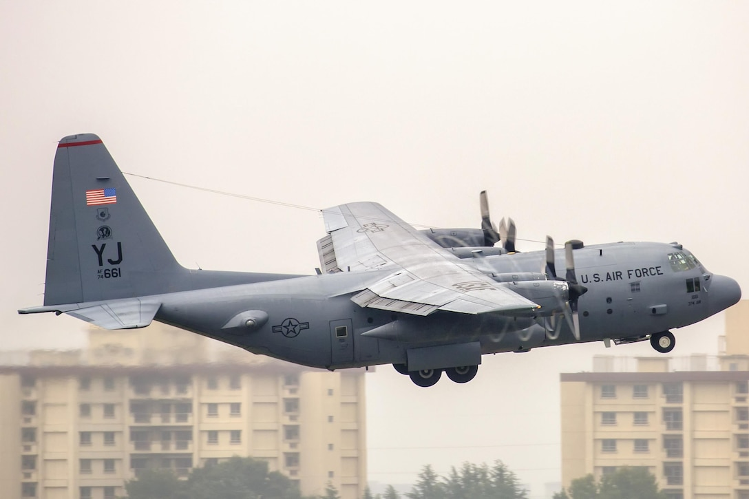 A C-130 Hercules, assigned to the 36th Airlift Squadron, takes off at Yokota Air Base, Japan, during a routine sortie Oct. 1, 2015. The 36th AS regularly conducts training missions to remain proficient in the necessary skills to support any contingency. (U.S. Air Force photo/Osakabe Yasuo)