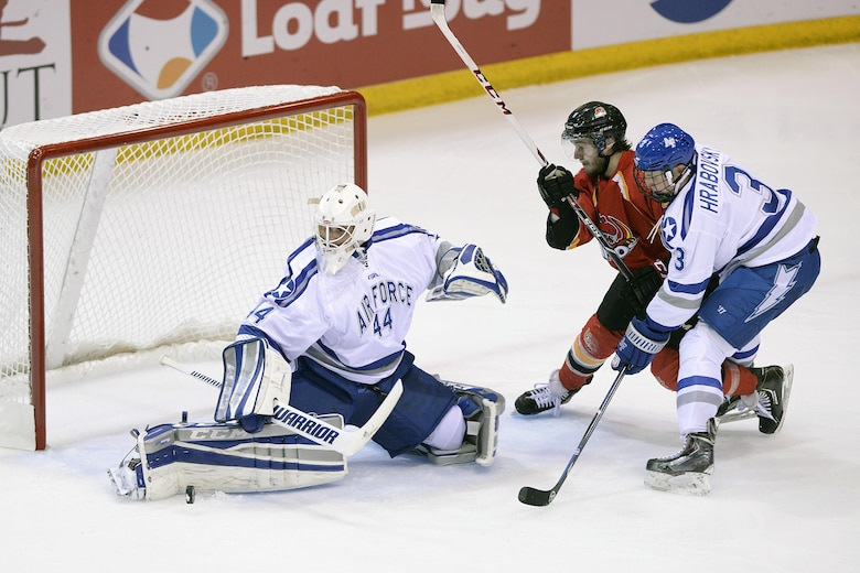 Billy Christopoulos, goalie for the U.S. Air Force Academy Falcons, deflects a shot as the Falcons met the University of Calgary Dinos in an exhibition college hockey matchup at the Academy's Cadet Ice Arena in Colorado Springs, Colo., Oct. 5, 2015. The Falcons defeated Calgary 5-0. Air Force opened its regular season against the No. 5 ranked University of Denver Pioneers at the Cadet Ice Arena Oct. 9. (U.S. Air Force photo/Mike Kaplan)