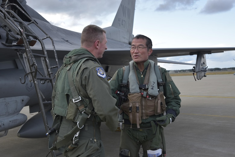 Lt. Gen. John Dolan, the U.S. Forces Japan commander, and Japan Air Self-Defense Force Lt. Gen. Yoshiyuki Sugiyama, the Air Defense Command commander, thank each other for the opportunity to demonstrate a great show of friendship by making a bilateral exchange flight possible at Misawa Air Base, Japan, Oct. 14, 2015. (U.S. Air Force photo/Senior Airman Jose L. Hernandez-Domitilo)