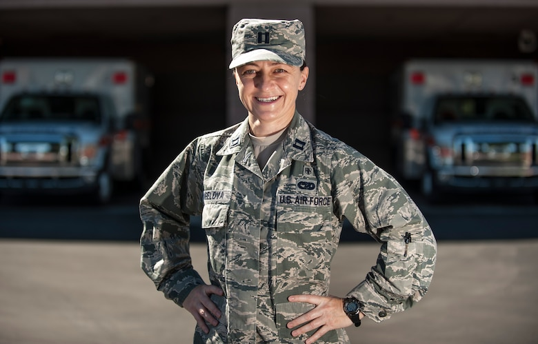 Capt. Reni Angelova, the 99th Medical Group practice manager, poses for a picture outside of the Mike O'Callaghan Federal Medical Center on Nellis Air Force Base, Nev., Oct. 7, 2015. She recently served in the Office of Defense Coordination in Bulgaria as an interpreter under the Language Enabled Airman Program. (U.S. Air Force photo/Staff Sgt. Siuta B. Ika)