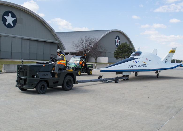 Restoration staff move the Martin X-24B into the new fourth building at the National Museum of the U.S. Air Force on Oct. 14, 2015. (U.S. Air Force photo by Ken LaRock)
