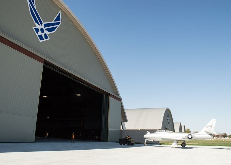 Restoration staff move the Republic YRF-84F Ficon into the new fourth building at the National Museum of the U.S. Air Force on Oct. 8, 2015. (U.S. Air Force photo by Ken LaRock)