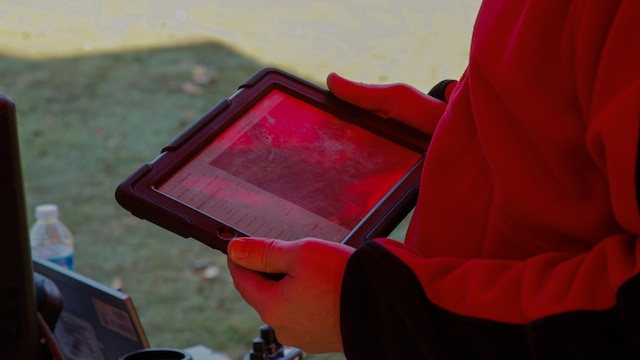 A tablet controls the Augmented Immersive Team Training demonstration for Marine leadership and key civilian leaders at the Medal of Honor Golf Course, Marine Corps Base Quantico, Virginia, Oct. 14, 2015. The system provides a virtual battlefield complete with aircraft and artillery to engage ground vehicles and personnel with no needs for concerns such as safety, resources or availability of ranges for realistic training.