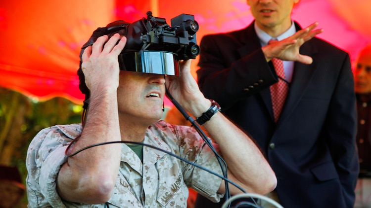 Maj. Gen. James Lukeman, commanding general, Training and Education Command, experiences the Augmented Immersive Team Training system during a demonstration for Marine leadership and key civilian leaders at the Medal of Honor Golf Course, Marine Corps Base Quantico, Virginia, Oct. 14, 2015. The system provides a virtual battlefield complete with aircraft and artillery to engage ground vehicles and personnel with no needs for concerns such as safety, resources or availability of ranges for realistic training.