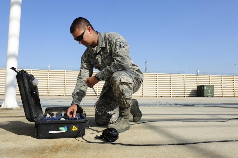 U.S. Air Force Tech. Sgt. Brett Larson, 134th Expeditionary Fighter Squadron F-16 Fighting Falcon crew chief, Vermont Air National Guard, retrieves a tool from his toolbox at Kunsan Air Base, Republic of Korea, Oct. 6, 2015. The 134th EFS was redeployed from Kadena Air Base, Japan to Kunsan AB as part of a theater security package. In an effort to underscore the U.S. commitment to regional security and stability, the 134th Expeditionary Fighter Squadron deployed to Kunsan as part of a rotational theater security package. (U.S. Air Force photo by Staff Sgt. Nick Wilson/Released)