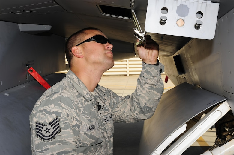 U.S. Air Force Tech. Sgt. Brett Larson, 134th Expeditionary Fighter Squadron F-16 Fighting Falcon crew chief, Vermont Air National Guard, inspects a hydraulic reservoir gage at Kunsan Air Base, Republic of Korea, Oct. 6, 2015. The 134th EFS was redeployed from Kadena Air Base, Japan to Kunsan AB as part of a theater security package. Larson deployed to Kunsan with more than 200 other guardsmen as part of a theater security package to increase large force U.S. military combat capabilities. (U.S. Air Force photo by Staff Sgt. Nick Wilson/Released)