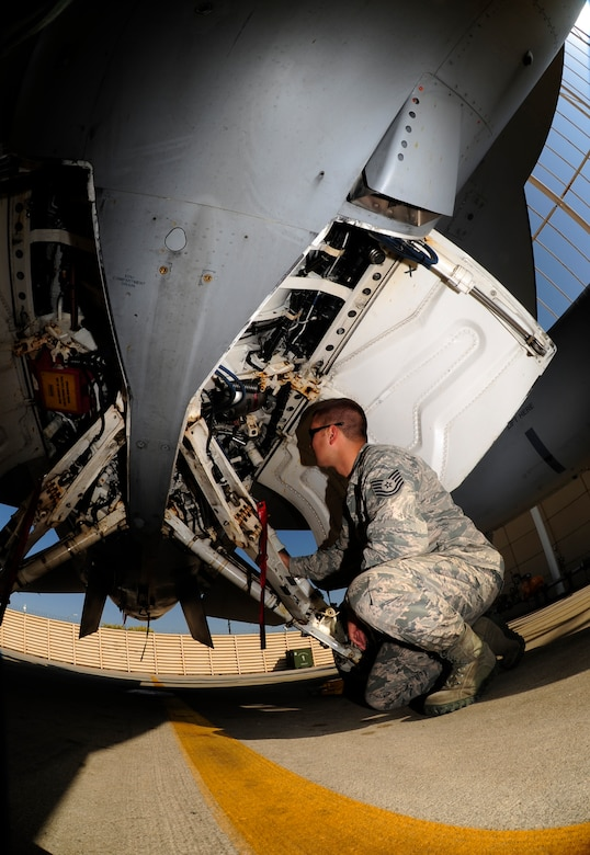 U.S. Air Force Tech. Sgt. Brett Larson, 134th Expeditionary Fighter Squadron F-16 Fighting Falcon crew chief, Vermont Air National Guard, inspects the landing gear of an F-16 at Kunsan Air Base, Republic of Korea, Oct. 6, 2015. The 134th EFS was redeployed from Kadena Air Base, Japan to Kunsan AB as part of a theater security package. TSP deployments provide the Asia-Pacific Region with forces capable of a variety of operations, including access to the global commons, disaster relief, global situational awareness, combating piracy, active defense and power projection. (U.S. Air Force photo by Staff Sgt. Nick Wilson/Released)