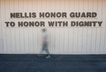 "A member of the Nellis Air Force Base Honor Guard walks during a team practice session at Nellis AFB, Oct. 13, 2015. The Nellis AFB Honor Guard's mission is ""To honor with dignity"" and each member is reminded of that when they see the front of the team's building. (U.S. Air Force photo by Staff Sgt. Siuta B. Ika)"