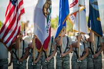 Members of the Nellis Air Force Base Honor Guard practice holding the colors while marching at Nellis AFB, Nev., Oct. 13, 2015. The team's precision, military discipline and attention to detail exemplify the standards expected of professional Airmen, and help represent the Air Force to the wider community. (U.S. Air Force photo by Staff Sgt. Siuta B. Ika)