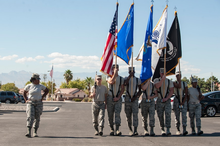 Members of the Nellis Air Force Base Honor Guard practice marching with the colors at Nellis AFB, Nev., Oct. 13, 2015. The team represents Nellis AFB and the Air Force in ceremonial functions in southern Nevada, Arizona, Utah and some areas of California. (U.S. Air Force photo by Staff Sgt. Siuta B. Ika)