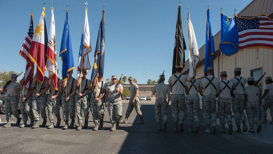 Members of the Nellis Air Force Base Honor Guard practice marching with the colors at Nellis AFB, Nev., Oct. 13, 2015. The team continuously trains and practices between its ceremonial events. (U.S. Air Force photo by Staff Sgt. Siuta B. Ika)