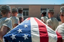Members of the Nellis Air Force Base Honor Guard practice properly carrying a casket at Nellis AFB, Nev., Oct. 13, 2015. For decades, the Nellis AFB Honor Guard has imparted tradition, ceremony and dignity to military funerals, public events and formal occasions. (U.S. Air Force photo by Staff Sgt. Siuta B. Ika)