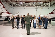 "Col. Ross R. Anderson (foreground, center), 926th Wing commander, administers the oath of enlistment to future Airmen of the 926th WG at Thunderbird Hangar on Nellis Air Force Base, Nev., Oct. 9, 2015. The 926th WG is headquartered at Nellis AFB and consists of two groups, 12 squadrons and one detachment located across the nation. Through Total Force Integration, reservists are integrated into regular Air Force units, accomplishing the U.S. Air Force Warfare Center and 432nd Wing/432nd Air Expeditionary Wing missions side-by-side regular Air Force personnel on a daily basis. During the swearing-in ceremony, Anderson said ""I'm envious of the adventures, challenges, successes and life-events that they are going to experience in their time in the Air Force. They have joined an elite culture, and they get to look forward to working with the best people in the greatest military to have ever existed."" (U.S. Air Force photo by Staff Sgt. Siuta B. Ika)"
