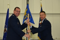 Major William Chapman assumes command of the 911th Maintenance Squadron, Oct. 3, 2015 at the Pittsburgh International Airport Air Reserve Station, Pa. Chapman became the new squadron commander of the 911 MXS after relinquishing command of the 434th Maintenance Squadron at Grissom Air Reserve Base, Ind. (U.S. Air Force photo by Senior Airman Marjorie A. Bowlden)