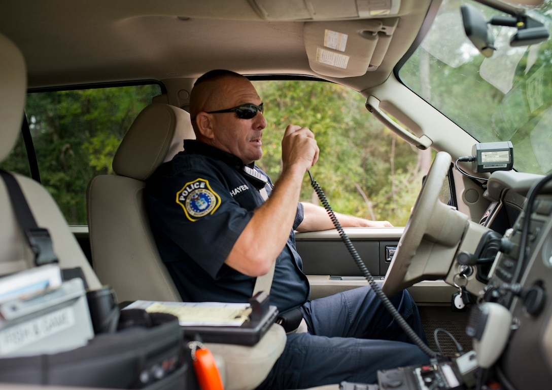 Mike Hayes, a range police officer, communicates via radio while on patrol Oct. 6 at Eglin Air Force Base, Fla.  The range police are responsible for the safety and security of Eglin range's mission, people and environment.  (U.S. Air Force photo/Samuel King Jr.)