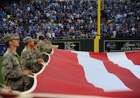 Airmen from Whiteman Air Force Base, Mo., perform a flag ceremony at Kauffman Stadium in Kansas City, Mo., Oct. 8, 2015. More than 20 service members held the flag before game one of the American League Divisional Series between the Houston Astros and the Kansas City Royals. (U.S. Air Force photo by Senior Airman Joel Pfiester/Released)
