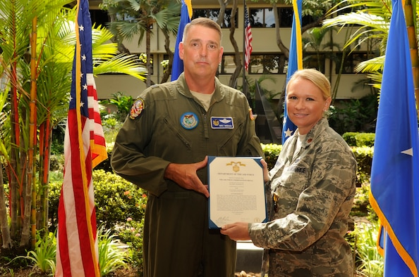 Brig. Gen. Michael Minihan presents Maj. Ashley Conner with a commendation medal for her work while supporting earthquake relief efforts in Nepal during a ceremony in the Courtyard of Heroes at the Pacific Air Force Headquarters Oct. 16. Conner, a Reservist with the 477th Fighter Group, deployed with the PACAF Joint Air Component Coordination Element to Nepal in May 2015. (U.S. Air Force/Master Sgt. Matthew McGovern)