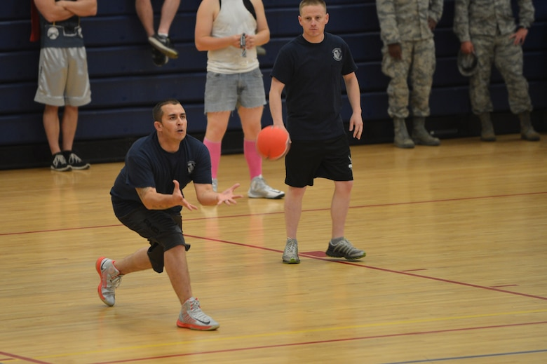 A Team Buckley member catches a dodgeball during the Combined Federal Campaign dodgeball tournament at the Fitness Center Oct. 13, 2015 on Buckley Air Force Base, Colo. Seventeen teams signed up to compete in the tournament, which helped raise more than $400. (U.S. Air Force photo by Staff Sgt. Darren Scott/Released)
