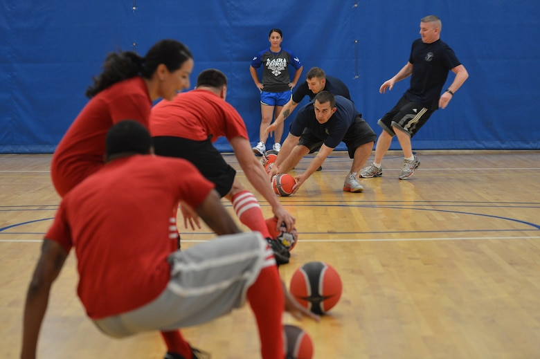 Two teams race to throw the first blow during the Combined Federal Campaign dodgeball tournament at the Fitness Center Oct.13, 2015, on Buckley Air Force Base, Colo. Seventeen teams signed up to compete in the tournament, which helped raise more than $400. (U.S. Air Force photo by Staff Sgt. Darren Scott/Released)