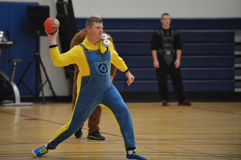 A Team Buckley member throws a dodgeball during the Combined Federal Campaign dodgeball tournament at the Fitness Center Oct. 13, 2015 on Buckley Air Force Base, Colo. Seventeen teams signed up to compete in the tournament, which helped raise more than $400. (U.S. Air Force photo by Staff Sgt. Darren Scott/Released)
