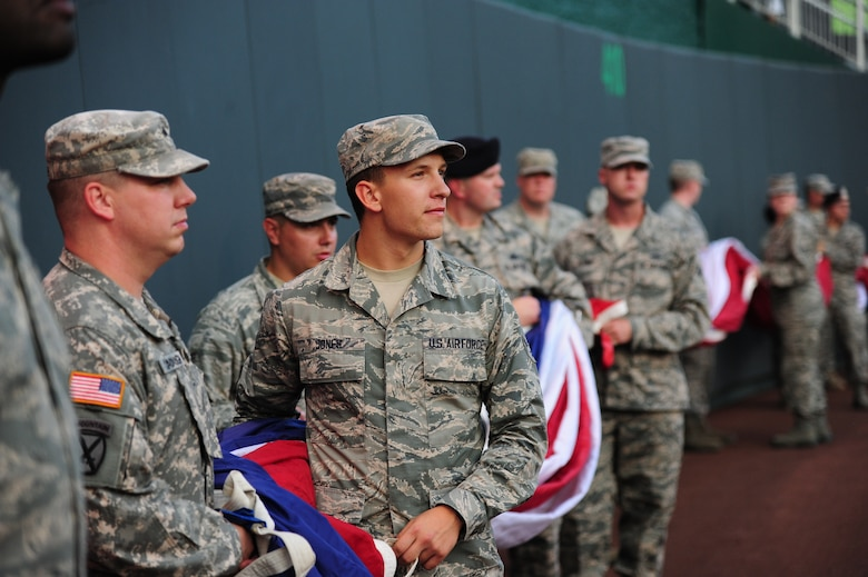 Airman 1st Class Corey Jones, 509th Operations Support Squadron air traffic control apprentice, looks at the crowd at Kauffman Stadium in Kansas City, Mo., Oct. 8, 2015. Airmen and Soldiers from Whiteman Air Force Base, Mo., participated in a flag ceremony before game one of the American League Divisional Series between the Houston Astros and the Kansas City Royals. (U.S. Air Force photo by Senior Airman Joel Pfiester/Released)