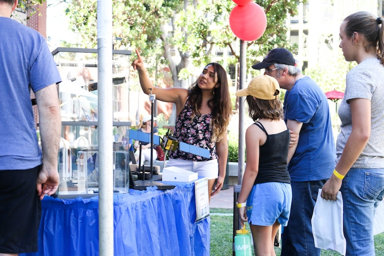 Samantha Marez, an Air Force Pathways engineering intern from the Space and Missile Systems Center's Military Satellite Communications Systems Directorate at Los Angeles Air Force Base in El Segundo, Calif., assists students in answering science and engineering questions at the University of Southern California's Viterbi School of Engineering. The Lasers 4 Ladies event on Oct. 10 focused on demonstrating optics and photonics to over 500 middle and high school female students from across the greater Los Angeles region. (USC courtesy photo/Peter Shin)