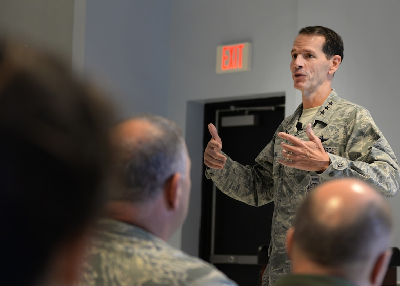 "Lt. Gen. Stanley E. ""Sid"" Clarke III, the director of the Air National Guard, speaks with members of the 157th Air Refueling Wing during an all-call at Pease Air National Guard Base, New Hampshire, Oct. 15. Clarke said during the all-call that he believes the Air Force selected the right organization to lead the Air National Guard through the transition of the KC-135 to the KC-46A Pegasus air refueling aircraft. The new weapon system is expected to arrive at Pease in 2018. (U.S. Air National Guard photo by Senior Airman Kayla Rorick)"