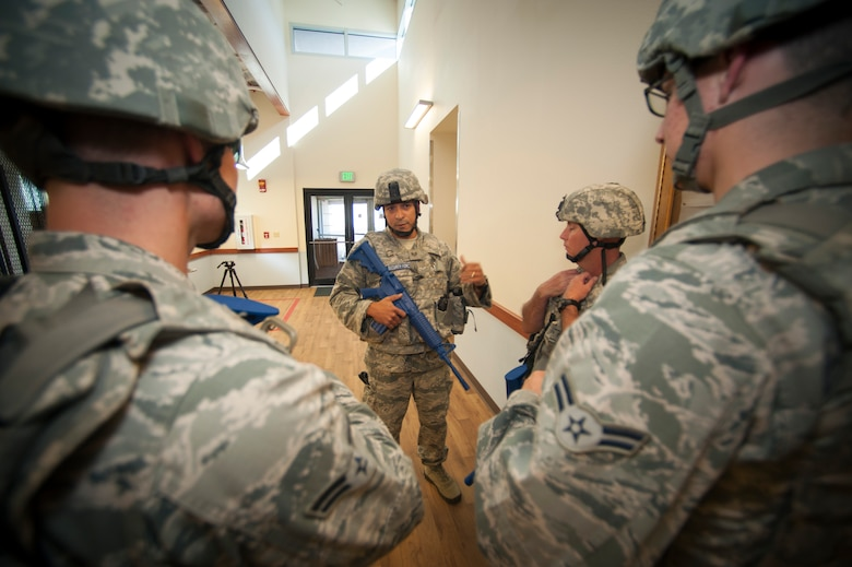 U.S. Air Force Staff Sgt. Johnny Ortiz, 140th Security Forces Squadron, Colorado Air National Guard, prepares his team members for a training exercise at Buckley Air Force Base, Aurora Colo., Oct. 15, 2015. This training is a part of the 140th Wing's 4-day, Wing Wartime Readiness Inspection, the U.S. Air Force's new evaluation system for wartime, contingency and force sustainment readiness.  (U.S. Air National Guard photo by Tech. Sgt. Wolfram M. Stumpf)