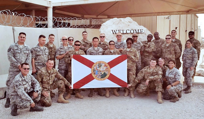 Members of the 290th JCSS proudly representing Florida as they begin their deployment in Southwest Asia.