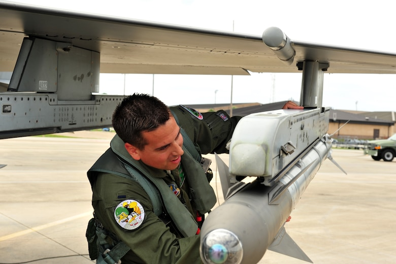 First Lt. Pete Fritz, an F-16 Fighter Pilot with the 180th Fighter Wing, Ohio Air National Guard, conducts a preflight inspection on an Air Intercept Missile, commonly referred to as an AIM 9 sidewinder, before a training sortie Sept. 15, 2015, at Tyndall Air Force Base, Fla. About 120 Airmen from the 180th FW traveled to Tyndall to participate in the Combat Archer exercise, a weapons system evaluation program designed to test the effectiveness of our Airmen and air-to-air weapon system capability of our F-16s and other combat aircraft. Training allows our pilots to provide a vital link for the defense of our country. Air National Guard photo by Senior Master Sgt. Beth Holliker/Released