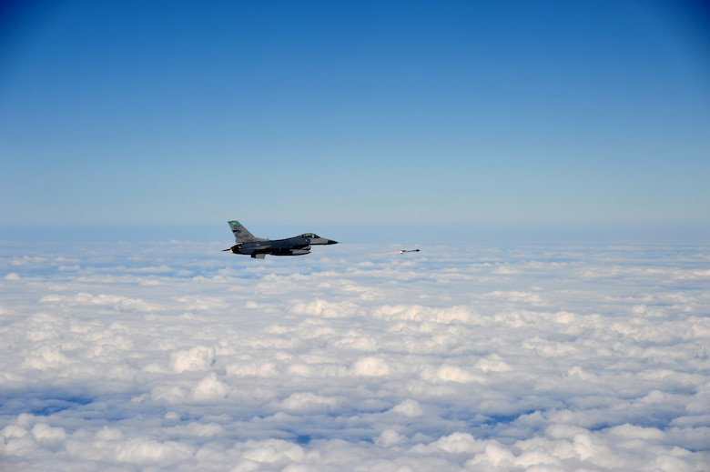 Lt. Col. Scott Schaupeter, an F-16 pilot with the 180th Fighter Wing, Ohio Air National Guard, flies an air-to-air sortie over the Gulf of Mexico Sept. 17. About 120 Airmen from the 180th FW traveled to Tyndall to participate in the Combat Archer exercise, a weapons system evaluation program designed to test the effectiveness of our Airmen and air-to-air weapon system capability of our F-16s and other combat aircraft. Training allows our pilots to provide a vital link for the defense of our country. Air National Guard photo by Maj. Garrick Webb/Released