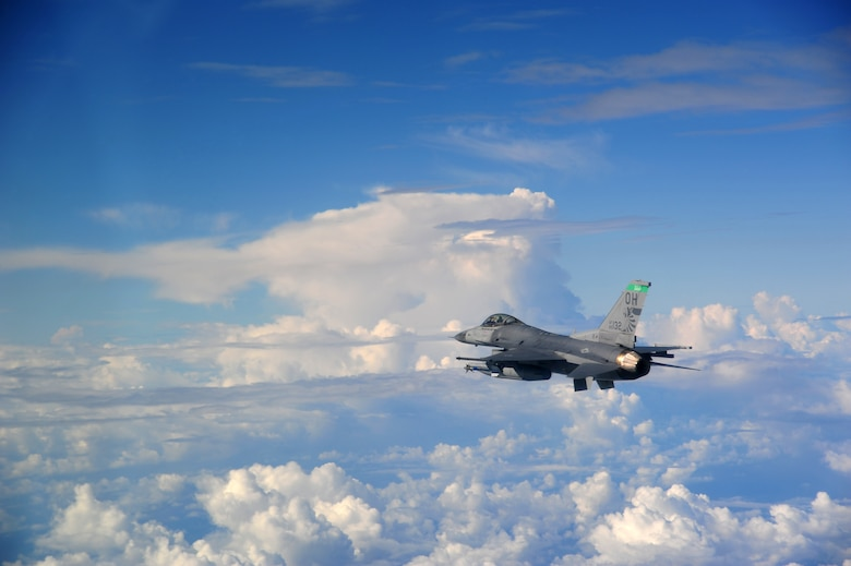 Lt. Col. Scott Schaupeter, an F-16 pilot with the 180th Fighter Wing, Ohio Air National Guard, flies an air-to-air sortie over the Gulf of Mexico Sept. 17, 2015. About 120 Airmen from the 180th FW traveled to Tyndall to participate in the Combat Archer exercise, a weapons system evaluation program designed to test the effectiveness of our Airmen and air-to-air weapon system capability of our F-16s and other combat aircraft. Training allows our pilots to provide a vital link for the defense of our country. Air National Guard photo by Maj. Garrick Webb/Released