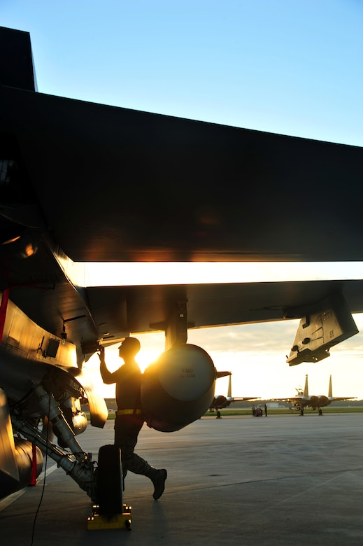 Senior Airman Josh Miller, an F-16 mechanic from the 180th Fighter Wing, Ohio Air National Guard, conducts a preflight inspection on a fighter jet before an early morning a training sortie Sept. 15, at Tyndall Air Force Base, Fla. About 120 Airmen from the 180th FW traveled to Tyndall to participate in the Combat Archer exercise, a weapons system evaluation program designed to test the effectiveness of our Airmen and air-to-air weapon system capability of our F-16s and other combat aircraft. Training allows our pilots to provide a vital link for the defense of our country. Air National Guard photo by Senior Master Sgt. Beth Holliker/Released