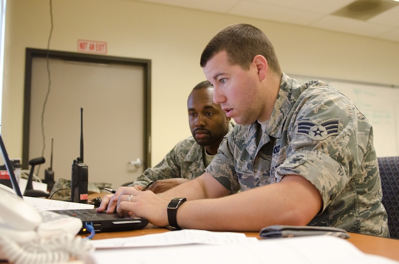 Tech Sgt. Spencer Walcot (left), a command support staff member for the Kentucky Air National Guard's 123rd Civil Engineer Squadron, and Senior Airman Clinton Cecil (right), an operations management specialist for the 123rd CES, provide communications links during a civil engineering training exercise held at March Air Reserve Base, Calif., on June 11, 2015. The exercise was designed to simulate a real-world mission. (U.S. Air National Guard photo by Senior Airman Joshua Horton)