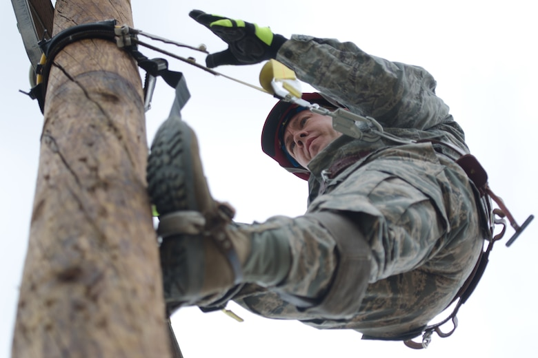 Master Sgt. Russ King, electrician superintendent for the Kentucky Air National Guard's 123rd Civil Engineer Squadron, climbs an electric pole during a training scenario at March Air Reserve Base, Calif., on June 9, 2015. The exercise was designed to simulate a real-world mission. (U.S. Air National Guard photo by Senior Airman Joshua Horton)