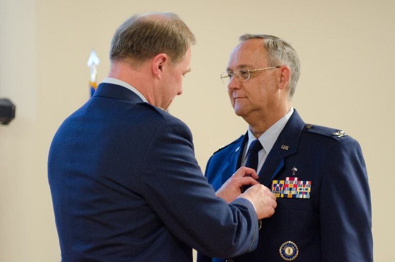 Brig. Gen. Steven P. Bullard (left), the chief of staff for Headquarters, Kentucky Air National Guard, pins Chaplain (Col.) Thomas Curry, the outgoing Air National Guard assistant to command chaplain for NORAD and USNORTHCOM, with the Defense Superior Service Medal during a ceremony at the Kentucky Air National Guard Base in Louisville, Ky. on June 6, 2015.  Curry is retiring after more than three decades of service to the Kentucky Air National Guard. (U.S. Air National Guard photo by Senior Airman Joshua Horton)